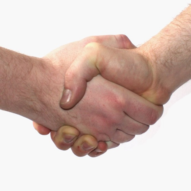 Handshake via Wikimedia Commons licensed Creative Commons 3.0.